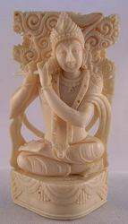 Ivory carving of the Indian deity Krishna, eighth avatar or reincarnation of the god Vishnu, the major god of Hinduism.  Krishna, the great lover, is also one of the most popular Hindu gods, often pictured playing his flute - museum quality (3.5 in tall)