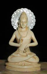 Small exquisite vintage Indian ivory Buddha seated in 'teaching posture' or dharmacakrapravartana mudra (2.4 in. tall)