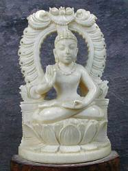 vintage Indian ivory Buddha seated in 'Gesture of Fearlessness' or 'blessing'  or abhaya mudra (5 in. tall) within an ornate aureole - early 20th C